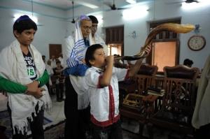 A Jewish Indian boy blows the 'Shofar' h
